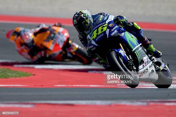 Movistar Yamaha MotoGP's Italian rider Valentino Rossi competes ahead of Repsol Honda Team's Spanish rider Dani Pedrosa during the San Marino Moto GP...