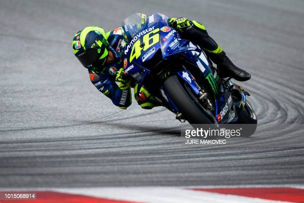 TOPSHOT Movistar Yamaha MotoGP's Italian rider Valentino Rossi competes during the qualifying session of the Austrian MotoGP Grand Prix at the Red...