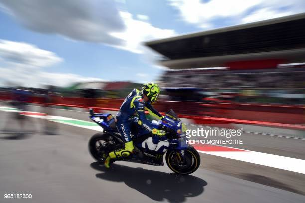 TOPSHOT Movistar Yamaha MotoGP's Italian rider Valentino Rossi exits the pit lane during a free practice session ahead of the Italian Moto GP Grand...