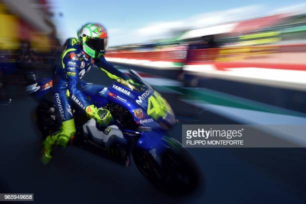 TOPSHOT Movistar Yamaha MotoGP's Italian rider Valentino Rossi exits the pit lane during the free practice of the Moto GP of the Italian Grand Prix...