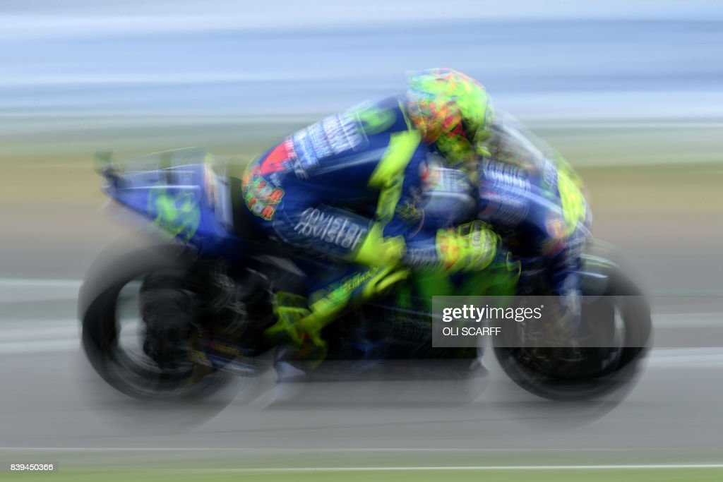TOPSHOT - Movistar Yamaha MotoGP's Italian rider Valentino Rossi exits Village Corner during the third free practice session of the British Grand Prix weekend at Silverstone circuit in Northamptonshire, southern England, on August 26, 2017. /