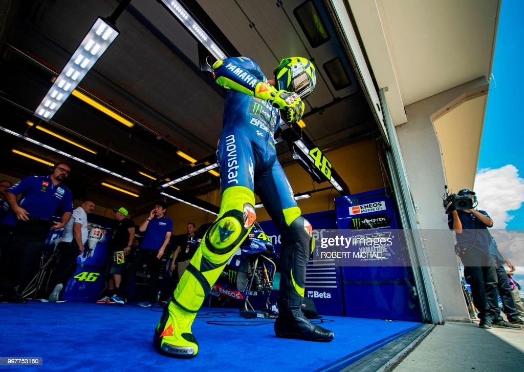 Movistar Yamaha MotoGP's Italian rider Valentino Rossi leaves the box prior to the second training session of the Moto GP for the Grand Prix of Germany at the Sachsenring Circuit on July 13, 2018 in Hohenstein-Ernstthal, eastern Germany.