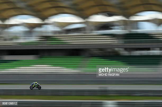TOPSHOT Movistar Yamaha MotoGP's Italian rider Valentino Rossi powers his bike during the last day of 2016 MotoGP preseason test at the Sepang...