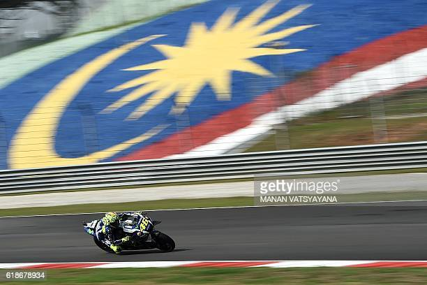 Movistar Yamaha MotoGP's Italian rider Valentino Rossi powers his bike during the first practice session of the Malaysian MotoGP at the Sepang...