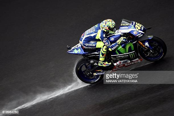 TOPSHOT Movistar Yamaha MotoGP's Italian rider Valentino Rossi powers his bike during the qualifying session of the 2016 Malaysian MotoGP at the...