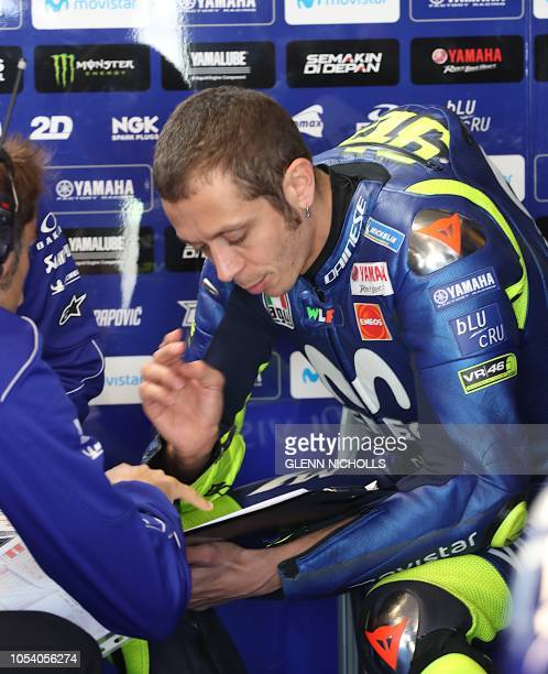 Movistar Yamaha MotoGP's Italian rider Valentino Rossi prepares to go out on the tracks for the third practice session at Phillip Island on October...