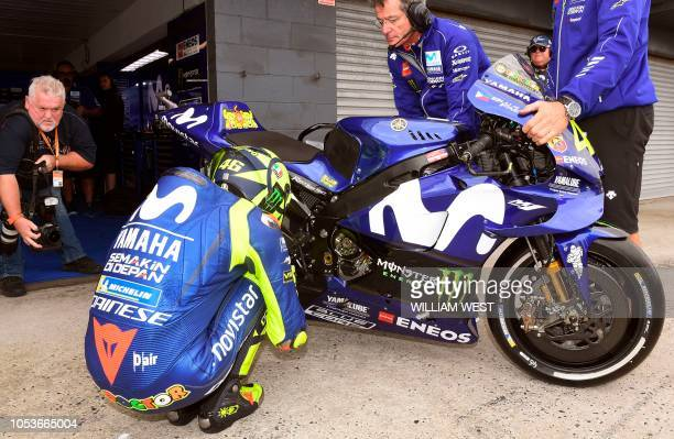 Movistar Yamaha MotoGP's Italian rider Valentino Rossi prepares to head out for the first MotoGP practice session at the Phillip Island circuit on...