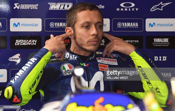 Movistar Yamaha MotoGP's Italian rider Valentino Rossi prepares to put on his helmet before the first MotoGP practice session at the Phillip Island...
