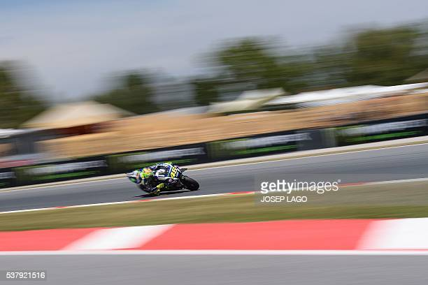Movistar Yamaha MotoGP's Italian rider Valentino Rossi rides at the Catalunya racetrack in Montmelo near Barcelona on June 3 during the Catalunya...