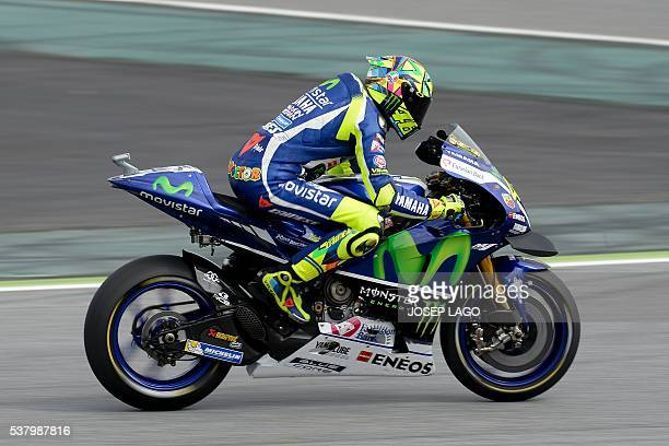 Movistar Yamaha MotoGP's Italian rider Valentino Rossi rides at the Catalunya racetrack in Montmelo near Barcelona on June 4 during the Catalunya...
