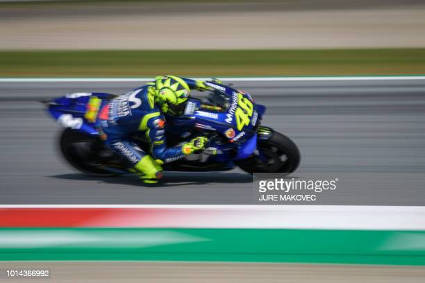 TOPSHOT Movistar Yamaha MotoGP's Italian rider Valentino Rossi rides during the first free practice of the Austrian MotoGP Grand Prix weekend at the...
