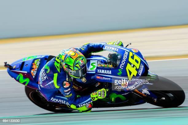 Movistar Yamaha MotoGP's Italian rider Valentino Rossi rides during the second MotoGP free practice session of the Moto Grand Prix de Catalunya at...