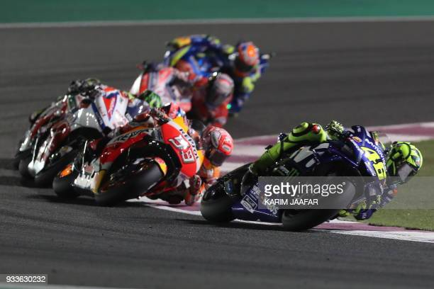 TOPSHOT Movistar Yamaha MotoGP's Italian rider Valentino Rossi rides his Yamaha ahead of Repsol Honda Team's Spanish rider Marc Marquez during the...