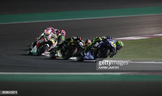Movistar Yamaha MotoGP's Italian rider Valentino Rossi rides his Yamaha ahead of Monster Yamaha Tech 3's French rider Johann Zarco and Ducati Team's...