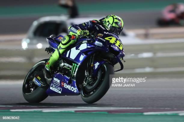 Movistar Yamaha MotoGP's Italian rider Valentino Rossi rides his Yamaha during the 2018 Qatar Moto GP Grand Prix at the Losail International Circuit...
