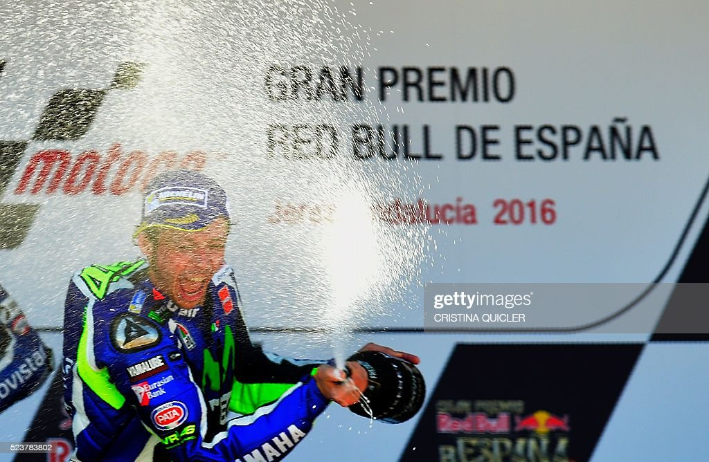 Movistar Yamaha MotoGP's Italian rider Valentino Rossi sprays cava as he celebrates his victory on the podium of the MotoGP race during the Spanish Moto Grand Prix at the Jerez racetrack in Jerez de la Frontera on April 24, 2016. / AFP / CRISTINA