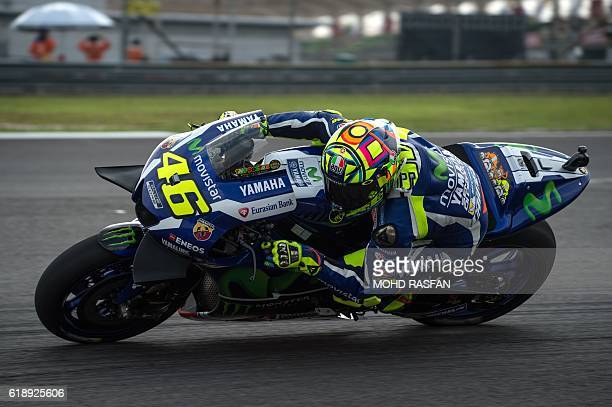 Movistar Yamaha MotoGP's Italian rider Valentino Rossi steers his bike during the third practice session of 2016 Malaysian MotoGP race at Sepang...