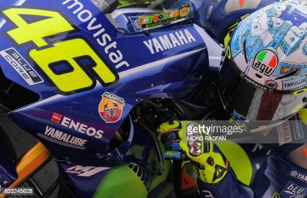 TOPSHOT Movistar Yamaha MotoGP's Italian rider Valentino Rossi takes a corner during the last day of 2017 MotoGP preseason test at the Sepang...