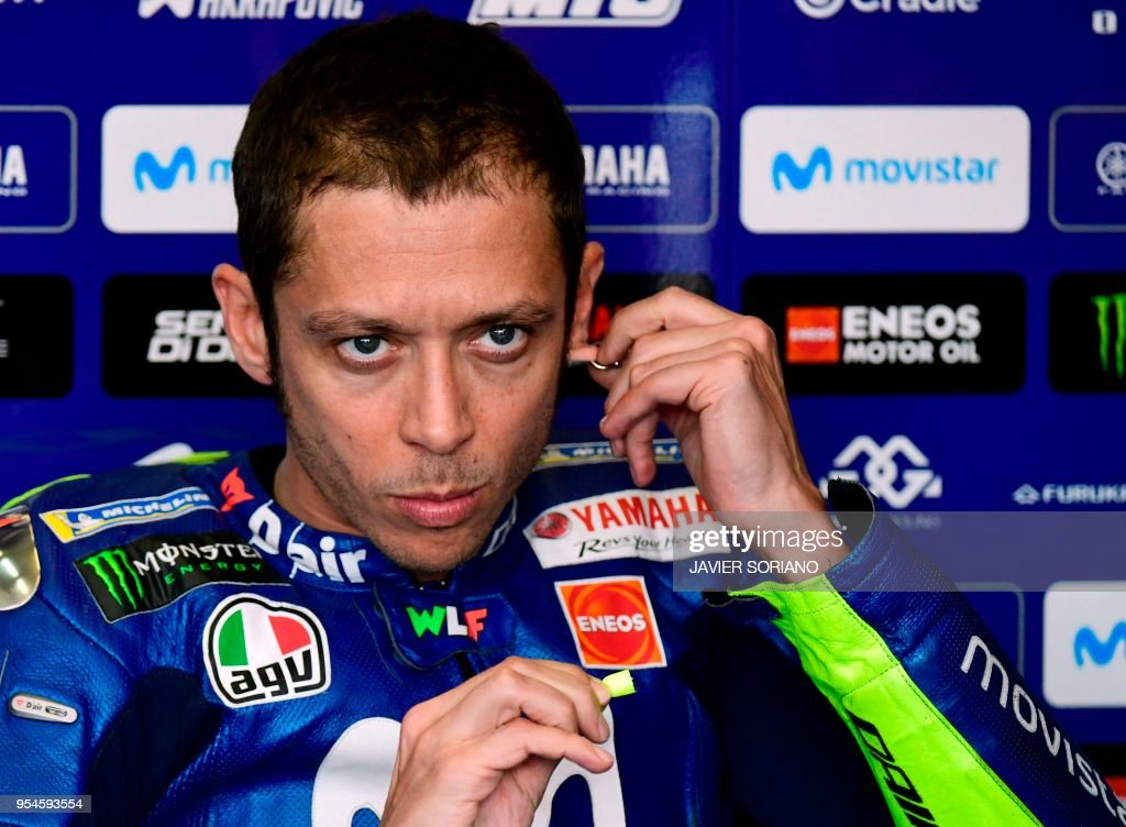 Movistar Yamaha MotoGP's Italian rider Valentino Rossi tuoches his earring as he waits for the the second MotoGP free practice session of the Spanish Grand Prix at the Jerez racetrack in Jerez de la Frontera on May 4, 2018.