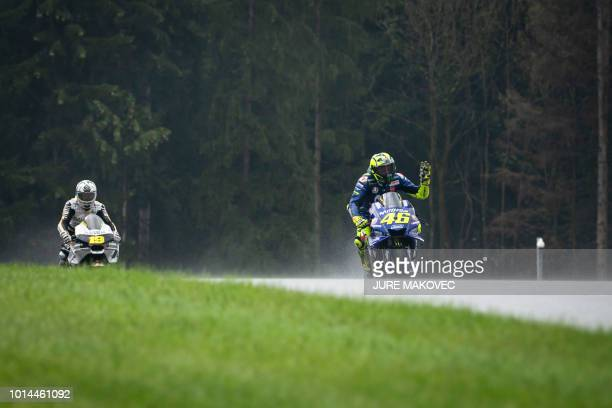TOPSHOT Movistar Yamaha MotoGP's Italian rider Valentino Rossi waves at the end of the second practice session of the Austrian MotoGP Grand Prix at...