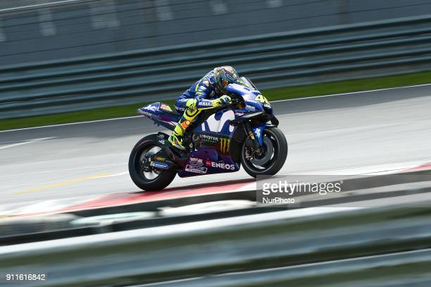 Movistar Yamaha MotoGP's rider Valentino Rossi of Italy powers his bike during the second day of the 2018 MotoGP preseason test at the Sepang...