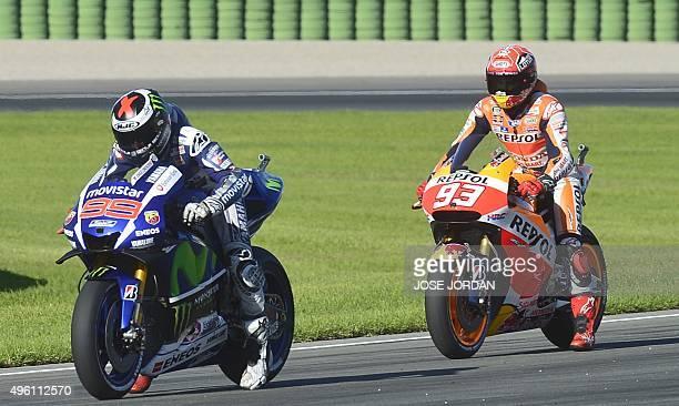 Movistar Yamaha MotoGP's Spanish rider Jorge Lorenzo and Repsol Honda Team's Spanish rider Marc Marquez practice for the start during the MotoGP...
