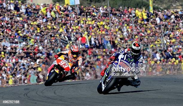 Movistar Yamaha MotoGP's Spanish rider Jorge Lorenzo and Repsol Honda Team's Spanish rider Marc Marquez ride during the MotoGP motorcycling race at...