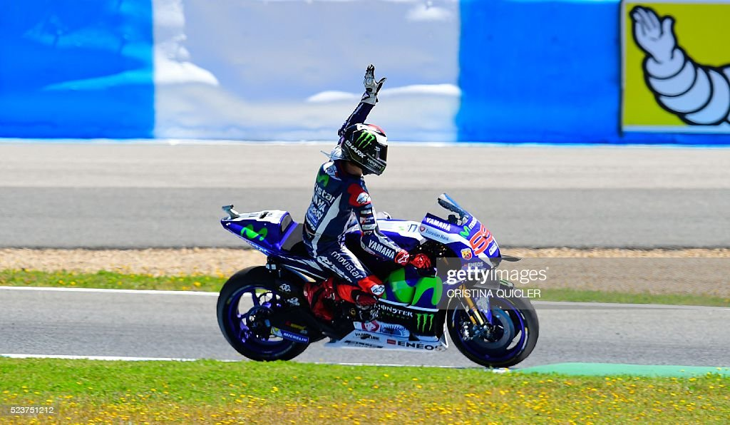 Movistar Yamaha MotoGP's Spanish rider Jorge Lorenzo celebrates his second place at the end of the MotoGP race during the Spanish Moto Grand Prix at the Jerez racetrack in Jerez de la Frontera on April 24, 2016. / AFP / CRISTINA
