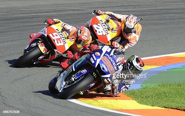 Movistar Yamaha MotoGP's Spanish rider Jorge Lorenzo Repsol Honda Team's Spanish rider Dani Pedrosa and Repsol Honda Team's Spanish rider Marc...