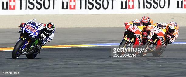 Movistar Yamaha MotoGP's Spanish rider Jorge Lorenzo rides ahead of Repsol Honda Team's Spanish rider Marc Marquez and Repsol Honda Team's Spanish...