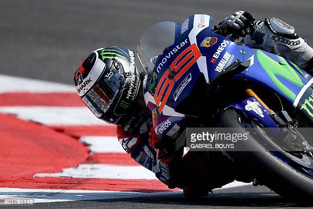 Movistar Yamaha MotoGP's Spanish rider Jorge Lorenzo rides his bike during the qualifying session at the Marco Simoncelli Circuit of the San Marino...