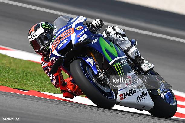 Movistar Yamaha MotoGP's Spanish rider Jorge Lorenzo takes a corner during the third practice session of 2016 Malaysian MotoGP race at Sepang...