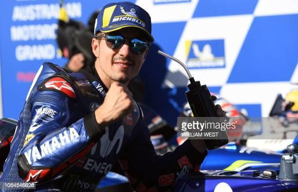 Movistar Yamaha MotoGP's Spanish rider Maverick Vinales celebrates his victory with teammates after the MotoGP Australian Grand Prix at Phillip...