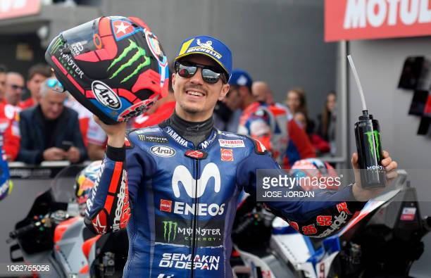 Movistar Yamaha MotoGP's Spanish rider Maverick Vinales celebrates earning pole position for tomorrow's race after the MotoGP qualifying session of...