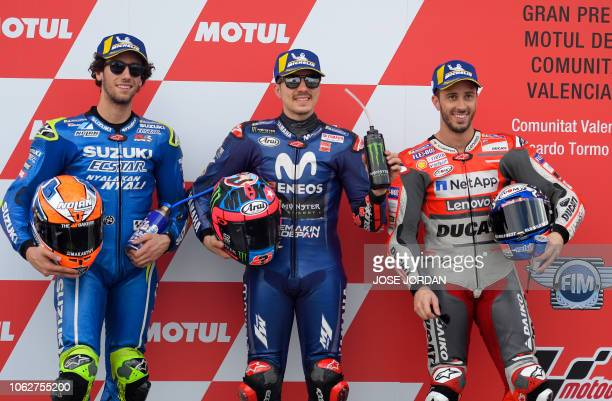 Movistar Yamaha MotoGP's Spanish rider Maverick Vinales celebrates earning pole position for tomorrow's race flanked by second placed Suzuki Ecstar...