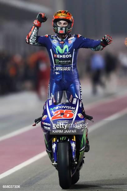 Movistar Yamaha MotoGP's Spanish rider Maverick Vinales celebrates after winning the 2017 Qatar MotoGP at the Losail International Circuit north of...