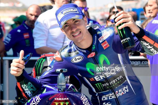 Movistar Yamaha MotoGP's Spanish rider Maverick Vinales celebrates being first after the Moto GP qualifier of the Moto Grand Prix of Aragon at the...
