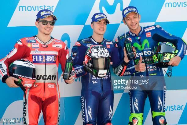 Movistar Yamaha MotoGP's Spanish rider Maverick Vinales , Ducati Team's Spanish rider Jorge Lorenzo and Movistar Yamaha MotoGP's Italian rider...