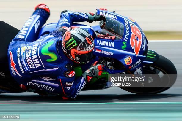 Movistar Yamaha MotoGP's Spanish rider Maverick Vinales rides during the second MotoGP free practice session of the Moto Grand Prix de Catalunya at...