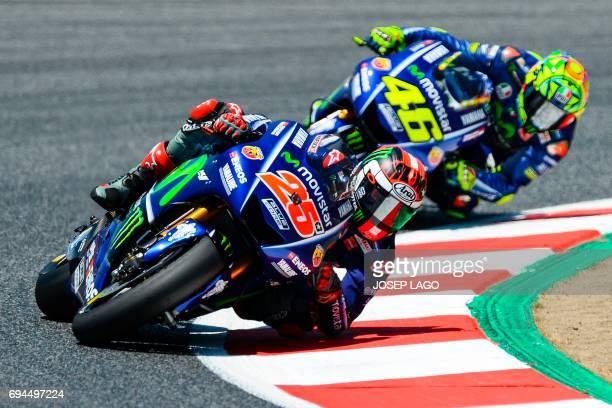 Movistar Yamaha MotoGP's Spanish rider Maverick Vinales rides followed by Movistar Yamaha MotoGP's Italian rider Valentino Rossi during the MotoGP...