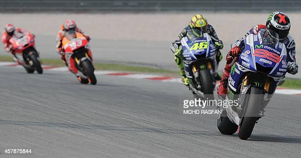 Movistar Yamaha rider Jorge Lorenzo of Spain Movistar Yamaha rider Valentino Rossi of Italy Repsol Honda Team rider Marc Marquez of Spain and Ducati...
