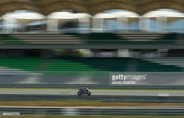 Movistar Yamaha rider Jorge Lorenzo of Spain steers his bike during the third and final day of MotoGP test races at the Sepang circuit outside Kuala...