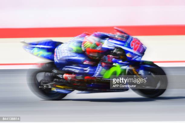 TOPSHOT Movistar Yamaha rider Maverick Vinales from Spain takes part in the free practice session at the Marco Simoncelli Circuit ahead of the San...