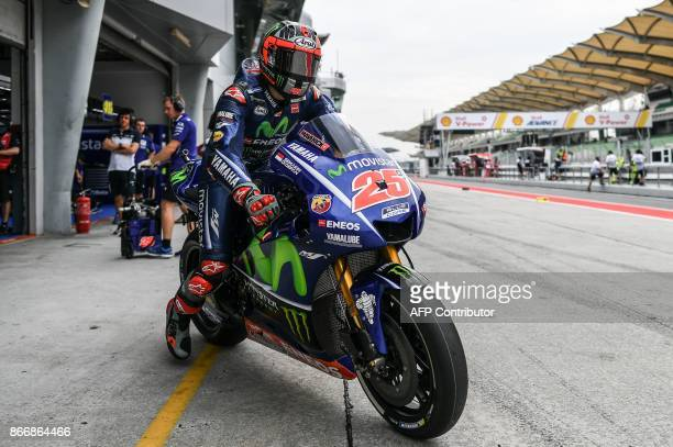 Movistar Yamaha Spanish rider Maverick Vinales leaves the pit lane during the first practice session of the Malaysia MotoGP at the Sepang...
