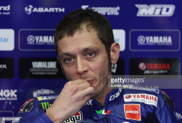 Movistar Yamaha's Italian driver Valentino Rossi speaks during a press conference following the MOTO GP qualifiers at the Losail International...