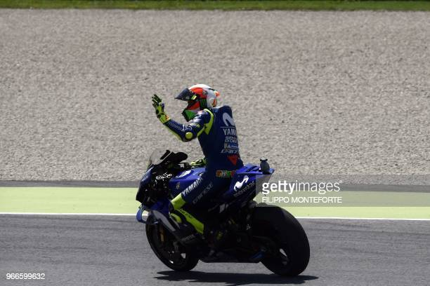 Movistar Yamaha's Italian rider Valentino Rossi acknowledges fans after coming third in the Moto GP Grand Prix at the Mugello race track on June 3...