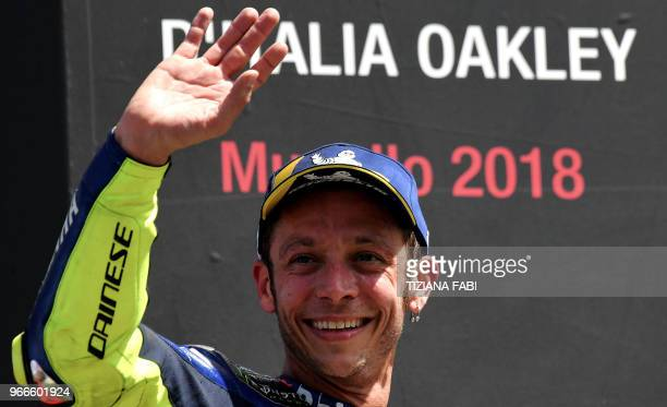Movistar Yamaha's Italian rider Valentino Rossi celebrates on the podium after he placed third in the Moto GP Grand Prix at the Mugello race track on...