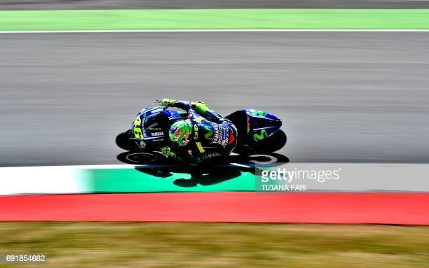 TOPSHOT Movistar Yamaha's Italian rider Valentino Rossi competes during the Moto GP qualifying session of the Italian Grand Prix at the Mugello...