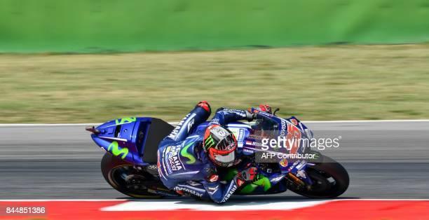 TOPSHOT Movistar Yamaha's rider Spanish Maverick Vinales rides his bike during a qualifying session for the San Marino Moto GP Grand Prix race at the...