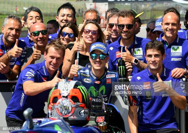 Movistar Yamaha's Spanish rider Maverick Vinales celebrates his pole position at the end of the Moto GP qualifying session of the Italian Grand Prix...